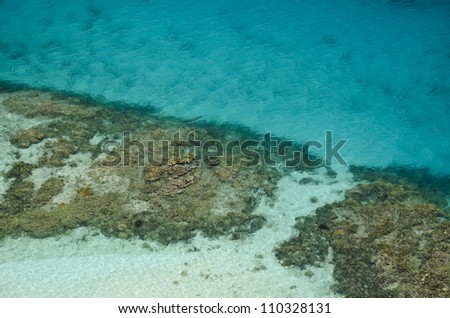 Aerial view of coral reef below clear waters, Guna Yala, San Blas archipelago, Panama, Central America.
