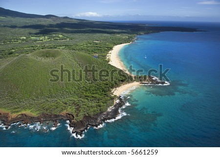 Aerial view of crater on Maui, Hawaii coast with beach. - stock photo