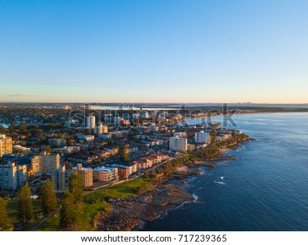 Aerial view of Cronulla coastline with clear blue sky.