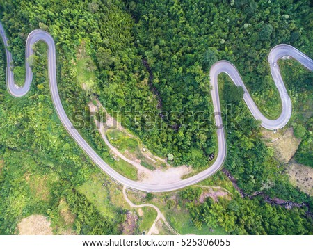 Aerial view of crooked path of road on the mountain, Shot from drone