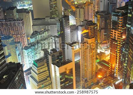 Aerial view of density Hong Kong city center at night - stock photo
