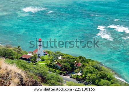 Aerial view of Diamond head lighthouse with azure ocean in background - stock photo