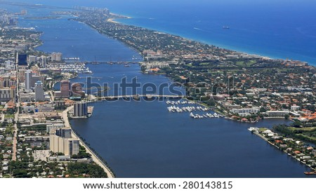 Aerial view of downtown West Palm Beach, Florida and Palm Beach - stock photo