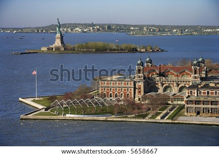 Aerial view of Ellis Island with Statue of Liberty, New York City. - stock photo