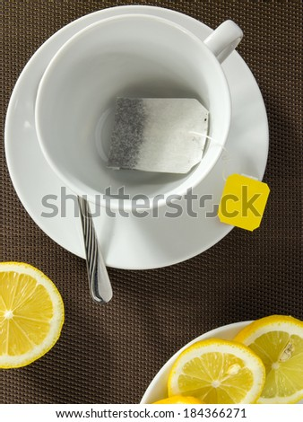 Aerial view of empty tea cup and slices of lemon