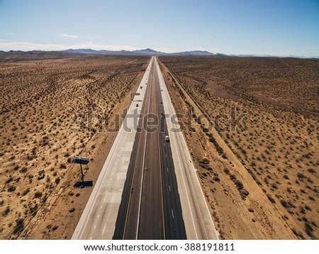 Aerial view of Endless road through desert park in California - stock photo