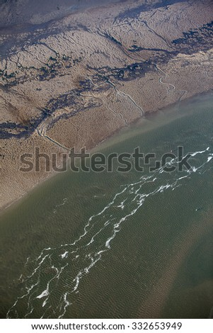 aerial view of estuary mudflat wetland of the shore of Ameland island, The Netherlands - stock photo