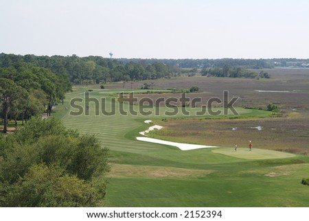 Aerial view of fairway of coastal golf course. - stock photo
