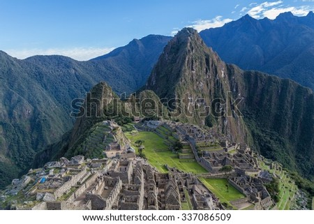 Aerial view of famous Mach Picchu ruins, Wayna Picchu mountain in the bacground. - stock photo
