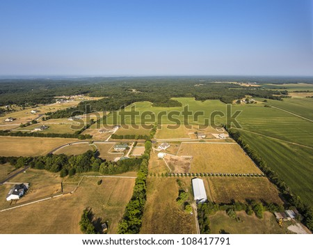 Aerial view of farm fields and trees in mid-west Missouri early morning - stock photo