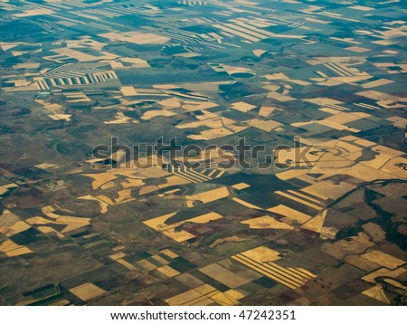 Aerial view of farm fields in Queensland, Australia Showing geometric patterns of individual crop areas - stock photo