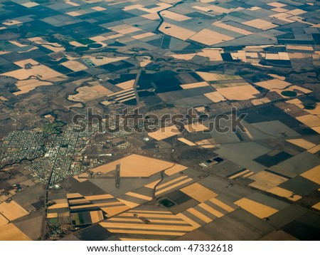 Aerial view of fertile farmlands Surrounding Urbane Sprawl of  the City of Bisbane in  Queensland Australia