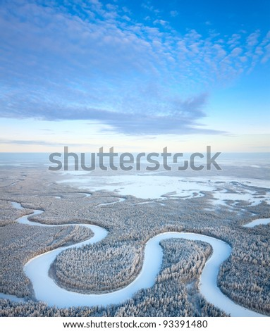 Aerial view of forest river in time of winter day. - stock photo