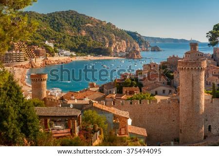 Aerial view of Fortress Vila Vella and Badia de Tossa bay at summer in Tossa de Mar on Costa Brava, Catalunya, Spain - stock photo