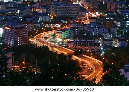 aerial view of Freeway Light trail to City at dusk in Pattaya, Thailand - stock photo