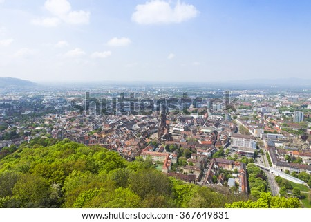 Aerial view of Freiburg im Breisgau city, Germany. Freiburg Munster and old town can be seen in the center - stock photo