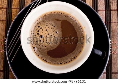 Aerial view of full coffee cup on the table