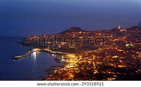 Aerial view of Funchal by night, Madeira Island, Portugal - stock photo