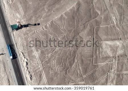 Aerial view of geoglyphs near Nazca - famous Nazca Lines, Peru. In the center, Tree figure is present. Observation tower and Panamericana highway on the left side. - stock photo