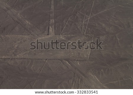 Aerial view of geoglyphs near Nazca - famous Nazca Lines, Peru. On the upper right side, Condor figure is present. - stock photo