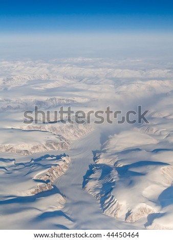 Aerial View of Glaciers, Mountains and Fjords of Auyuittuq National Park, Baffin Island, Canada (66.81 N, 65.43 W) - stock photo