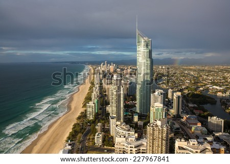 Aerial view of Gold Coast , with rainbow over suburbs - stock photo