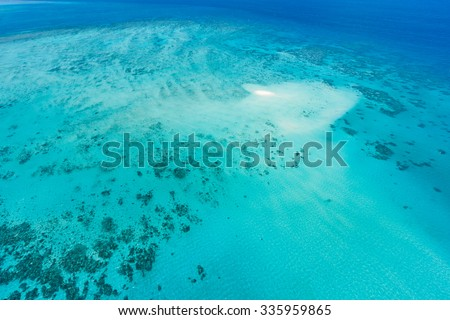 Aerial view of Great Barrier Reef and coral sand cay from helicopter flight, Queensland, Australia - stock photo