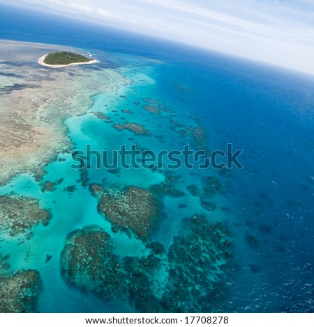 Aerial view of Great Barrier Reef with clear blue water, Queensland, Australia - stock photo