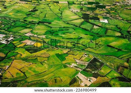 Aerial view of green farmland of the countryside - stock photo