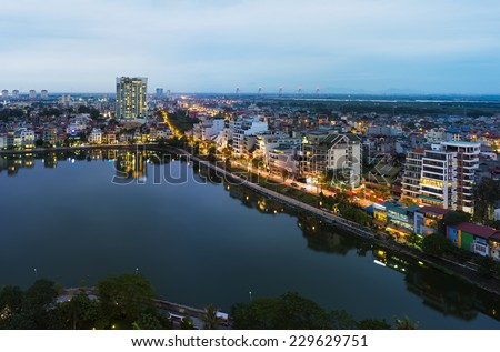 Aerial view of Hanoi skyline at West Lake ( Ho Tay in Vietnamese), at twilight