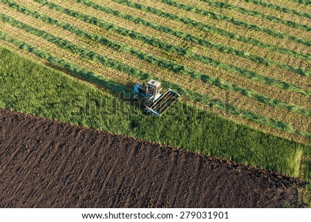 aerial view of harvest fields with combine in Poland