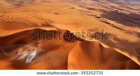 Aerial view of high red dunes, located in the Namib Desert, in the Namib-Naukluft National Park of Namibia, Africa - stock photo