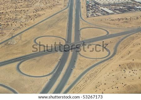 Aerial view of highway interchange in the desert in UAE - stock photo