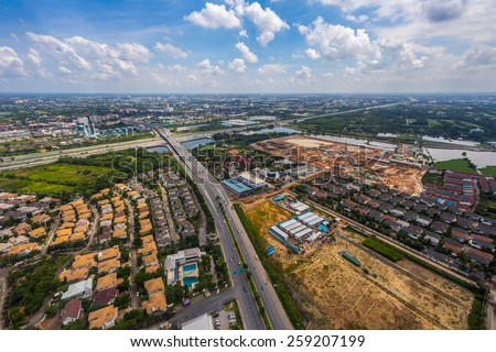 Aerial view of highway near Village. - stock photo