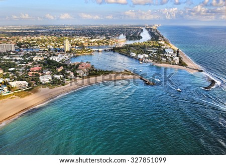 aerial view of hillsboro inlet from atlantic ocean to intracoastal waterway in southeast florida - stock photo