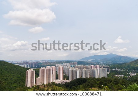 aerial view of hong kong  over-crowded apartment buildings in a residential area in a sunny day with white clouds and blue sky