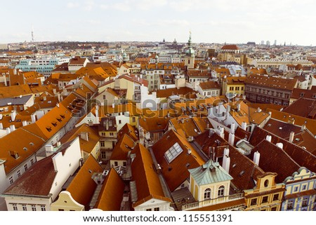 Aerial view of houses and roofs typical of Prague old city town,Czech Republic. - stock photo