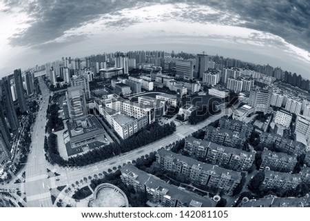 Aerial view of houses and streets in big cities - stock photo
