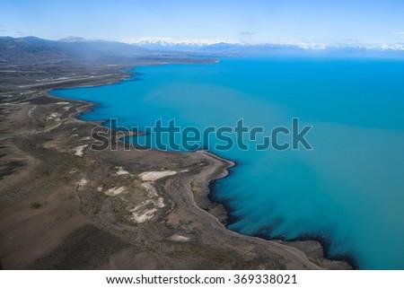 Aerial view of huge blue lake in Patagonia - stock photo