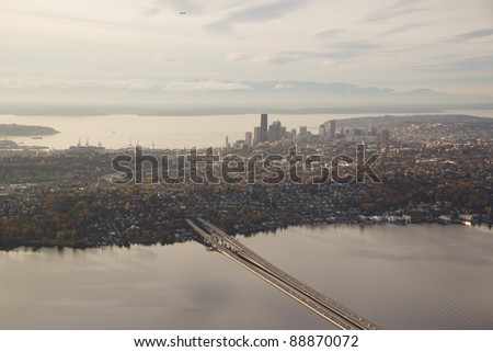 Aerial view of I-90 floating bridge leading into Seattle at sunset