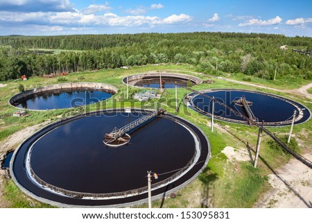 Aerial view of industrial sewage treatment plant - stock photo