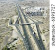 Aerial view of interstate 10 in southwest desert landscape of Arizona. - stock photo