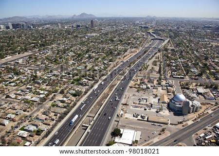 Aerial view of Interstate 10 traffic cutting through the heart of Phoenix, Arizona - stock photo