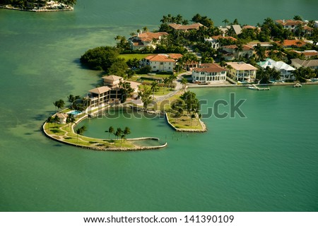Aerial view of islands and generic real estate in the area of Miami, Florida. - stock photo