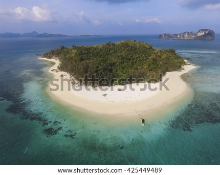 Aerial view of isolated beautiful tropical island with white sand beach.  Bamboo Island, Phi Phi Islands, Phuket, Thailand. - stock photo