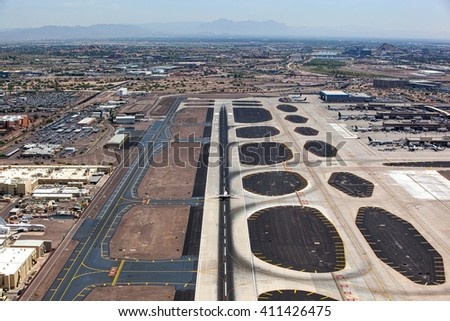 Aerial view of jet airliner landing at the international airport in Phoenix, Arizona - stock photo