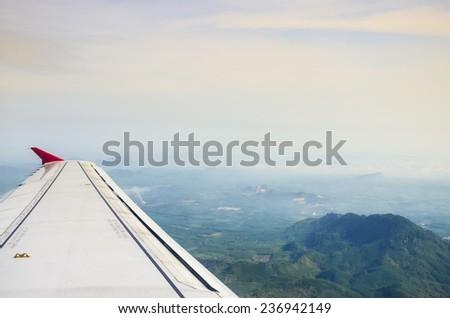Aerial View of jet plane wing, Trang, Thailand - stock photo