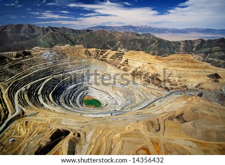 Aerial view of Kennecott's Bingham Canyon Mine - an open-pit copper mine - largest man-made excavation on earth - stock photo