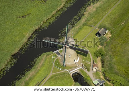 Aerial view of Kinderdijk windmills, Zuid-Holland, Netherlands. Those ancient windmills are on the UNESCO world heritage list.