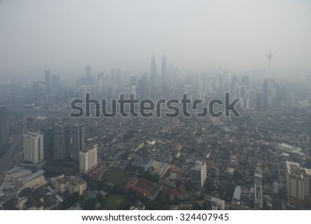 Aerial View of Kuala Lumpur during hazy, Kuala Lumpur is the capital city of Malaysia. - stock photo